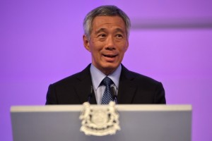 Singapore Prime Minister  Lee Hsien Loong delivers his opening address at the 14TH Asia Security Summit at the International Institute for Strategic Studies (IISS) Shangri-La Dialogue 2015 in Singapore on May 29, 2015. Asian countries led by China and Japan should put World War II behind them to promote regional trust and cooperation, Singapore Prime Minster Lee Hsien Loong said on May 29. AFP PHOTO / ROSLAN RAHMAN